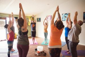 Holistic Yoga Studio, artwork in background, dianadellos.com